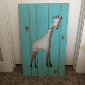 Wooden giraffe sign